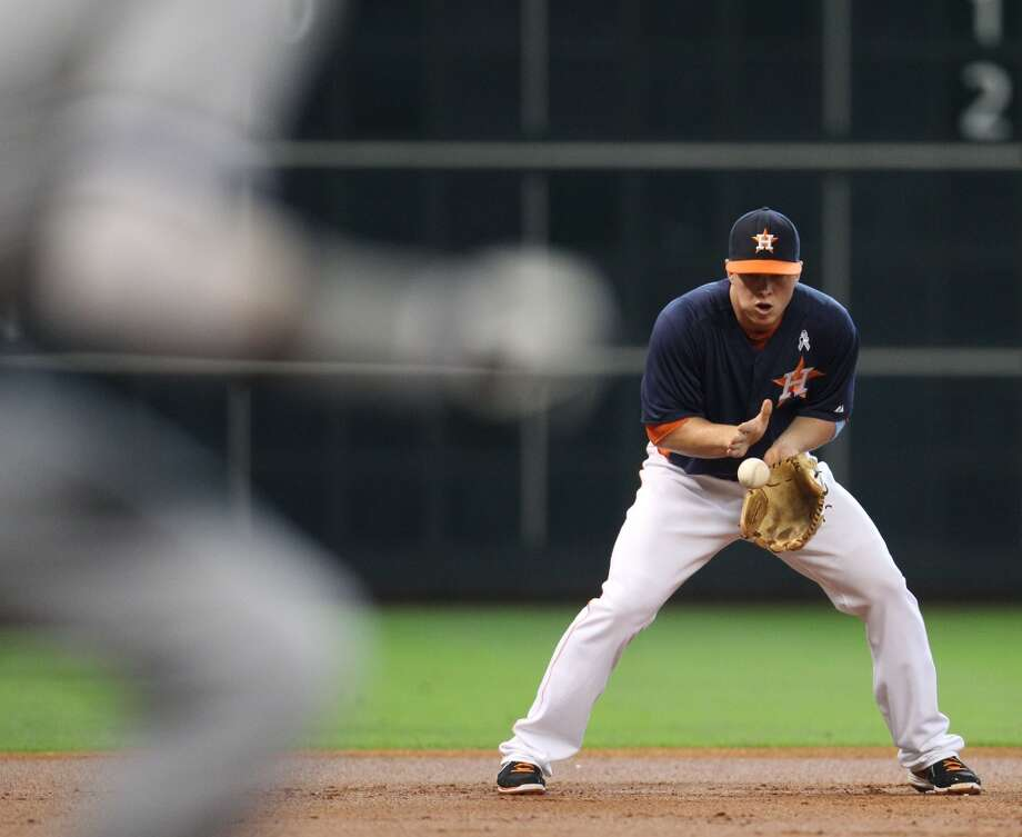 Astros third baseman Matt Dominguez fields a ball hit by Alexei Ramirez of the White Sox.