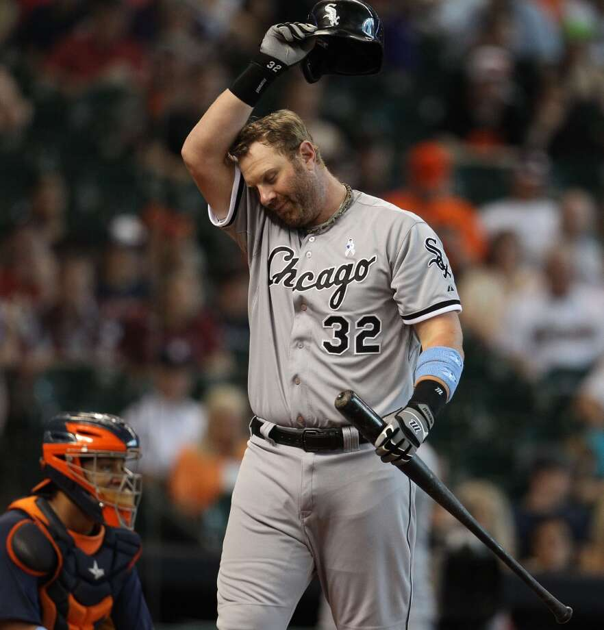 Adam Dunn of the White Sox pauses to wipe off sweat during an at-bat against the Astros.