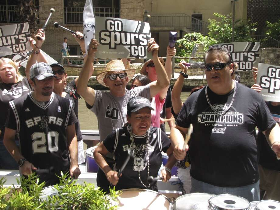 San Antonio Spurs fans packed two river barges Sunday afternoon in a pep rally for the hometown team.