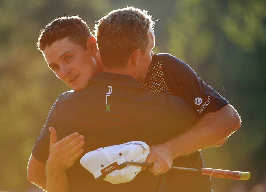 ARDMORE, PA - JUNE 16:  Justin Rose of England embraces caddie Mark Fulcher after putting on the 18th hole to complete the final round of the 113th U.S. Open at Merion Golf Club on June 16, 2013 in Ardmore, Pennsylvania. Photo: Ross Kinnaird, Getty Images / 2013 Getty Images
