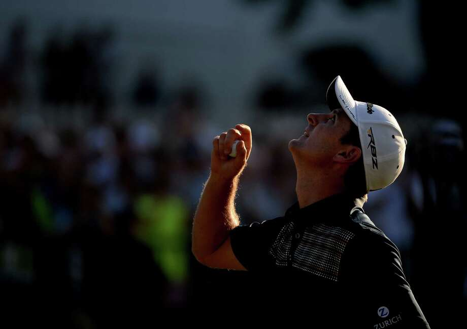 ARDMORE, PA - JUNE 16:  Justin Rose of England looks to the heavens in acknowledgement of his deceased father after putting on the 18th hole to complete the final round of the 113th U.S. Open at Merion Golf Club on June 16, 2013 in Ardmore, Pennsylvania. Photo: Ross Kinnaird, Getty Images / 2013 Getty Images