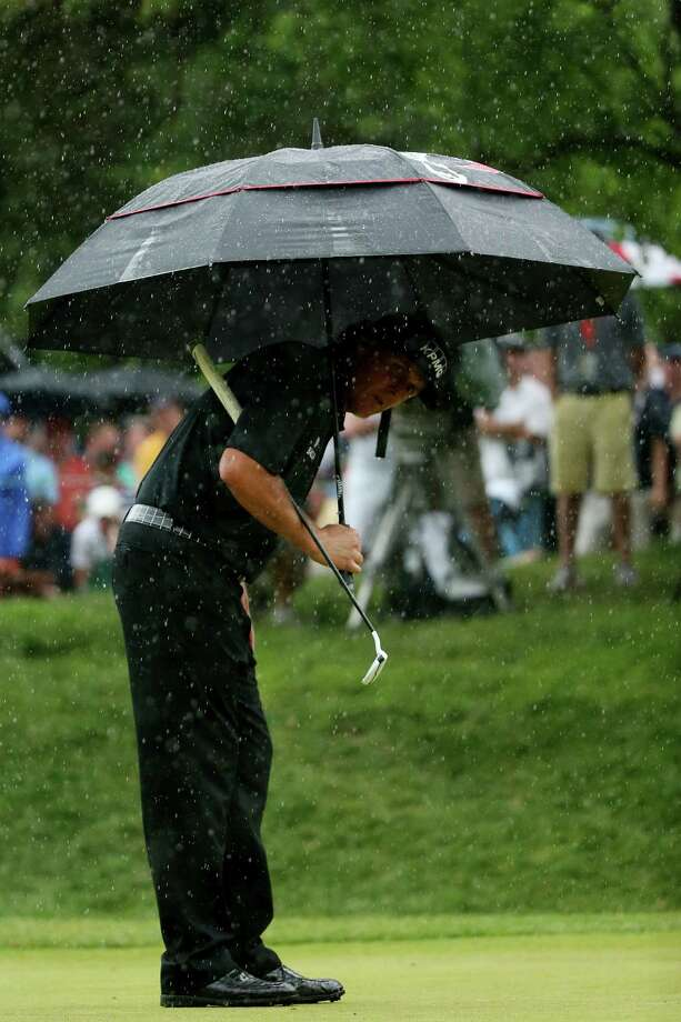 ARDMORE, PA - JUNE 16: Phil Mickelson of the United States holds an umbrella as he lines up his putt on the 12th hole during the final round of the 113th U.S. Open at Merion Golf Club on June 16, 2013 in Ardmore, Pennsylvania. Photo: Andrew Redington, Getty Images / 2013 Getty Images