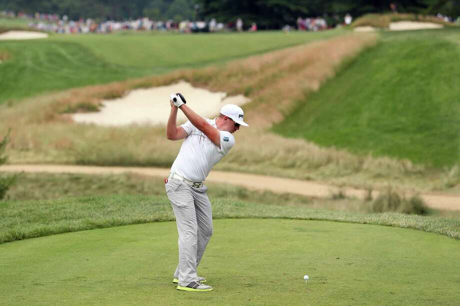 ARDMORE, PA - JUNE 16:  Hunter Mahan of the United States hits his tee shot on the fourth hole during the final round of the 113th U.S. Open at Merion Golf Club on June 16, 2013 in Ardmore, Pennsylvania. Photo: Andrew Redington, Getty Images / 2013 Getty Images