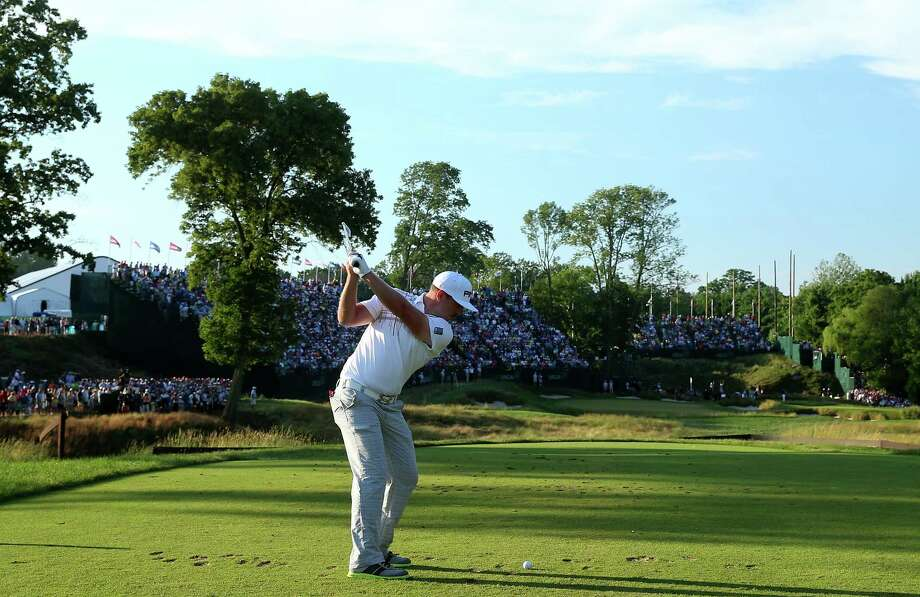 ARDMORE, PA - JUNE 16:  Hunter Mahan of the United States hits his tee shot on the 17th hole during the final round of the 113th U.S. Open at Merion Golf Club on June 16, 2013 in Ardmore, Pennsylvania. Photo: Andrew Redington, Getty Images / 2013 Getty Images