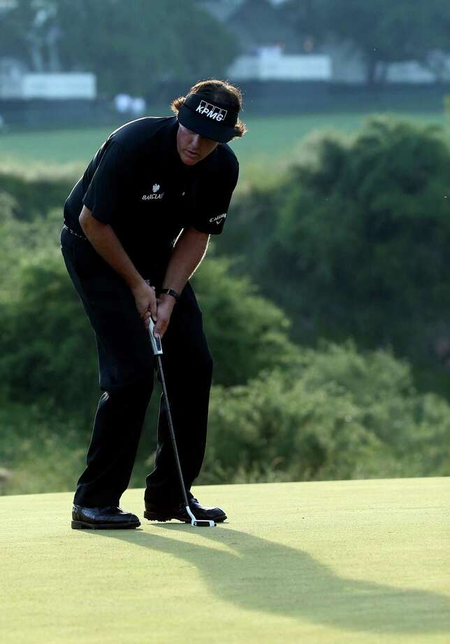 ARDMORE, PA - JUNE 16:  Phil Mickelson of the United States reacts to a missed putt on the 16th hole during the final round of the 113th U.S. Open at Merion Golf Club on June 16, 2013 in Ardmore, Pennsylvania. Photo: Andrew Redington, Getty Images / 2013 Getty Images