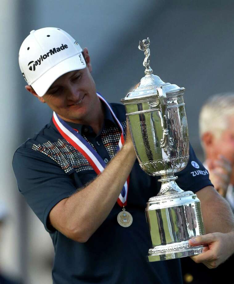 Justin Rose, of England, celebrates with the trophy after winning the U.S. Open golf tournament at Merion Golf Club, Sunday, June 16, 2013, in Ardmore, Pa. (AP Photo/Julio Cortez) Photo: Julio Cortez, Associated Press / AP