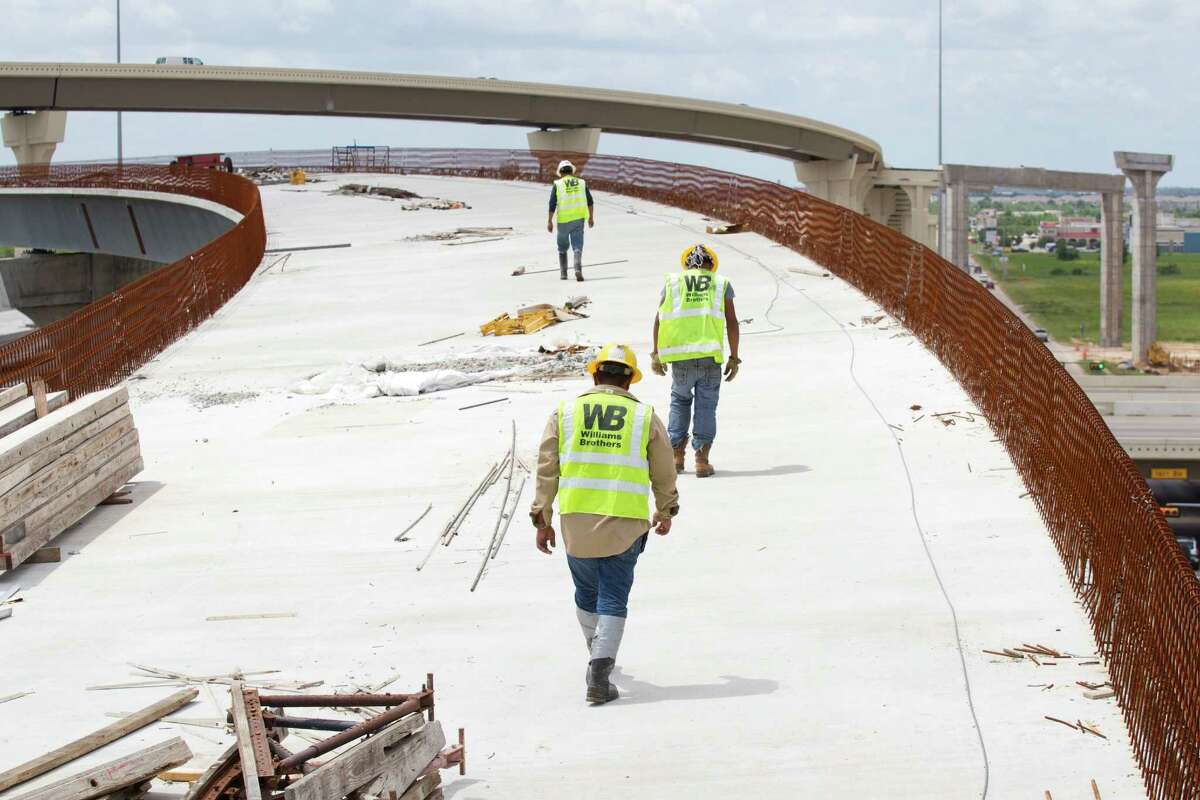 Construction crew continue work on the connector from I-10 to the Grand Parkway Friday, May 31, 2013, northwest of Houston.