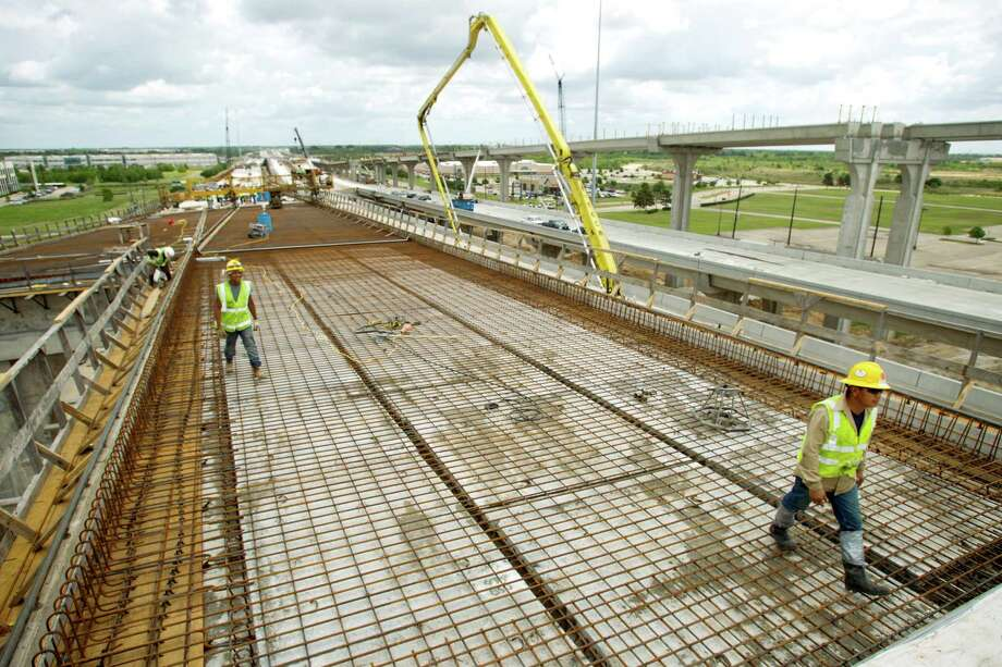 Construction crew continue work on the connector from I-10 to the Grand Parkway Friday, May 31, 2013, northwest of Houston. Photo: Brett Coomer, Houston Chronicle / © 2013 Houston Chronicle