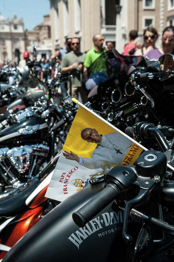 Harley Davidson motorcycles are parked along 'Via della Conciliazione' during the mass for the 'Evangelium Vitae' Day at St. Peter's Square on June 16, 2013 in Vatican City, Vatican. Photo: Giorgio Cosulich, Getty Images / 2013 Getty Images