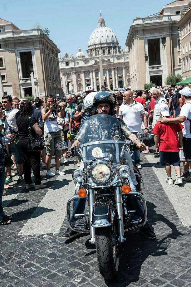 Harley Davidson riders park their motorcycles along 'Via della Conciliazione' during the mass for the 'Evangelium Vitae' Day at St. Peter's Square on June 16, 2013 in Vatican City, Vatican. Photo: Giorgio Cosulich, Getty Images / 2013 Getty Images