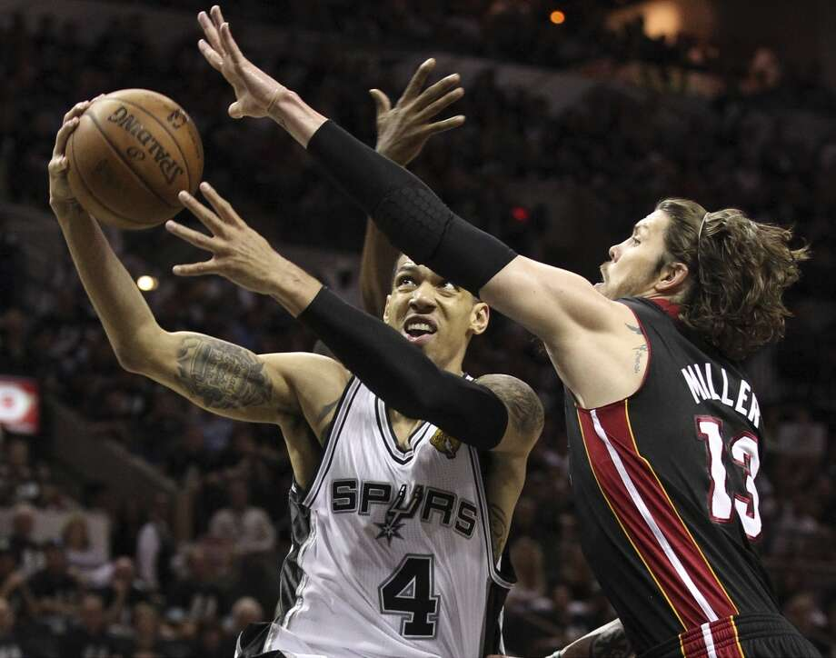 San Antonio Spurs' Danny Green drives past Miami Heat's Mike Miller during the first half of Game 5 of the NBA Finals at the AT&T Center on Sunday, June 16, 2013. (Kin Man Hui/San Antonio Express-News)