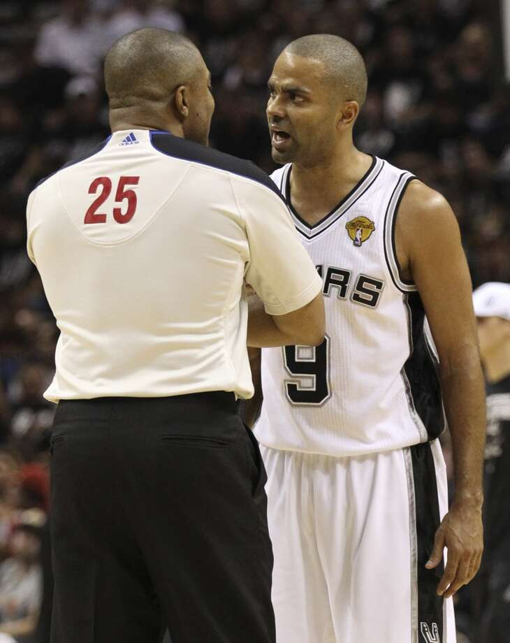 San Antonio Spurs' Tony Parker talks with referee Tony Brothers during the first half of Game 5 of the NBA Finals at the AT&T Center on Sunday, June 16, 2013. (Kin Man Hui/San Antonio Express-News)