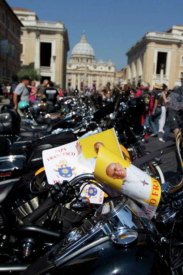 Harley Davidson motorcycles riders park their motorcycles in Via della Conciliazione leading to the Vatican, seen at top, as they wait for Pope Francis to drive by to bless them ahead of mass in St. Peter's Square, at the Vatican, Sunday, June 16, 2013. The riders are gathered in Rome for a four-day event to celebrate the motorcycle company's 110th anniversary.  (AP Photo/Andrew Medichini) Photo: Andrew Medichini, Associated Press / AP