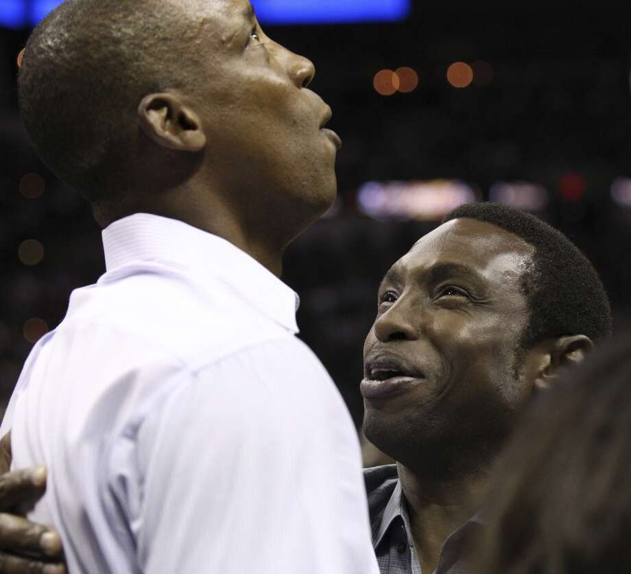 Former Spurs Sean Elliot and Avery Johnson talk before the start of Game 5 of the NBA Finals at the AT&T Center on Sunday, June 16, 2013. (Kin Man Hui/San Antonio Express-News)