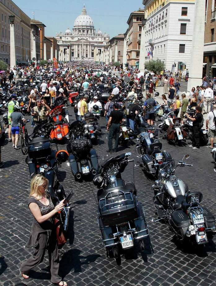 Harley-Davidson motorcycles are parked in Via della Conciliazione leading to St. Peter's Square during a Mass celebrated by Pope Francis, at the Vatican, Sunday, June 16, 2013. Pope Francis on Sunday blessed thousands of Harley Davidsons and their riders as the American motorcycle manufacturer celebrated its 110th anniversary with a loud parade and plenty of leather. (AP Photo/Riccardo De Luca) Photo: Riccardo De Luca, Associated Press / AP