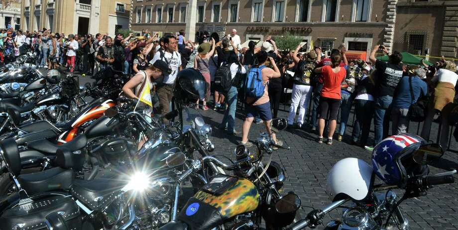 "Pope Francis (C) blesses Harley-Davidson motorbikers before the mass for the day of ""Evangelium Vitae"" in Via della Conciliazione on June 16, 2013 at Vatican city. Harley-Davidson owners arrived in Rome to celebrate the motorcycle brand's 110th anniversary. Photo: ALBERTO PIZZOLI, AFP/Getty Images / AFP"
