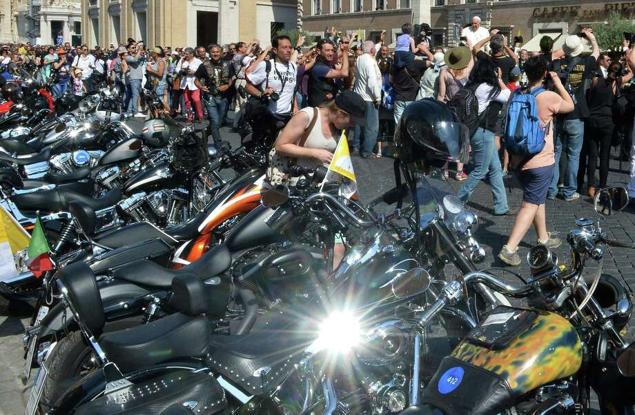 "Pope Francis (R up) blesses Harley-Davidson motorbikers before the mass for the day of ""Evangelium Vitae"" in Via della Conciliazione on June 16, 2013. at the Vatican. Photo: ALBERTO PIZZOLI, AFP/Getty Images / AFP"