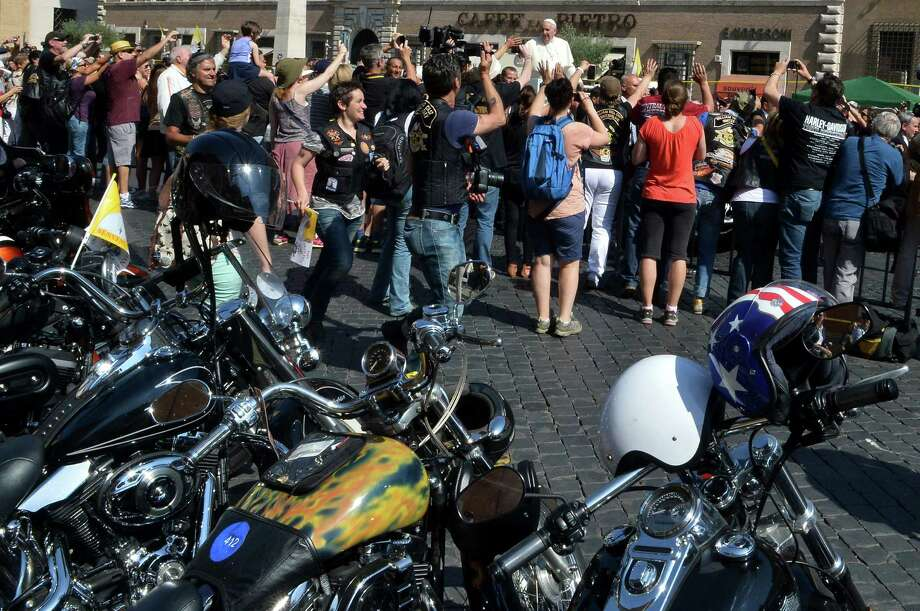 "Pope Francis (C) blesses Harley-Davidson motorbikers before the mass for the day of ""Evangelium Vitae"" in Via della Conciliazione on June 16, 2013 at the Vatican city. Photo: ALBERTO PIZZOLI, AFP/Getty Images / AFP"
