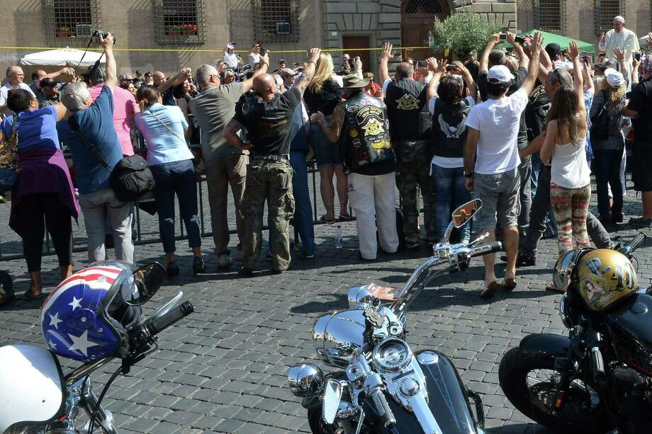 "Pope Francis (R) blesses Harley-Davidson motorbikers before the mass for the day of ""Evangelium Vitae"" in Via della Conciliazione on June 16, 2013 at the Vatican city. Photo: ALBERTO PIZZOLI, AFP/Getty Images / AFP"