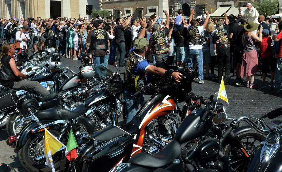 "Pope Francis (R) blesses Harley-Davidson bikers on June 16, 2013 before a mass for the day of ""Evangelium Vitae"" on Via della Conciliazione at the Vatican. Harley-Davidson riders arrived in Rome to celebrate the motorcycle brand's 110th anniversary. Photo: ALBERTO PIZZOLI, AFP/Getty Images / AFP"