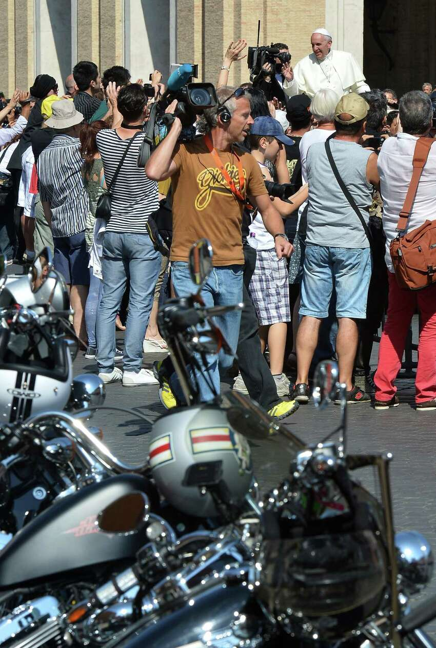 Pope Francis (R) blesses Harley-Davidson bikers on June 16, 2013 before a mass for the day of