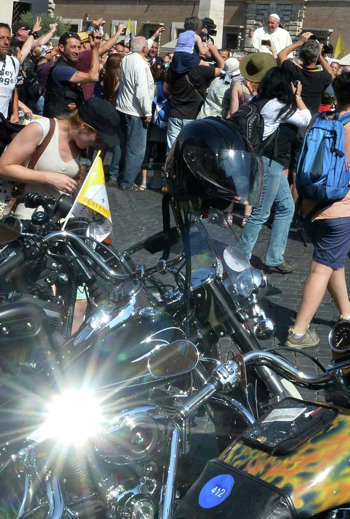 Pope Francis (up R) blesses Harley-Davidson motorbikers before the mass for the day of