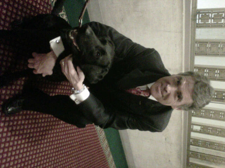 According to his Twitter, Perry is posing with Ellie, a member of the K-9 cops in Philadelphia.