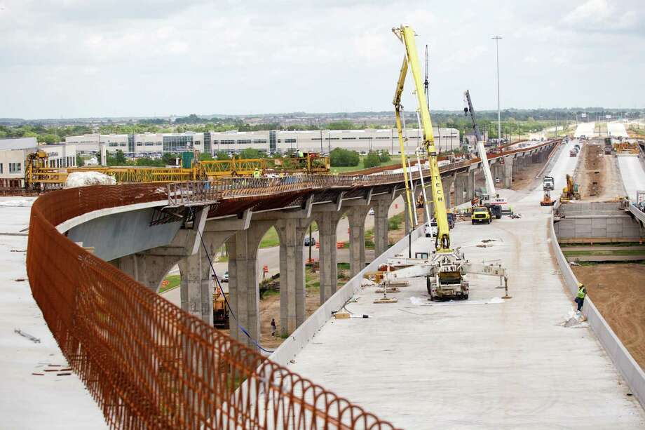 Construction crews are busy building the connector from I-10 to the Grand Parkway. The freeway will be the first Houston-area toll road that will be managed by Tx-DOT. Photo: Brett Coomer, Staff / © 2013 Houston Chronicle