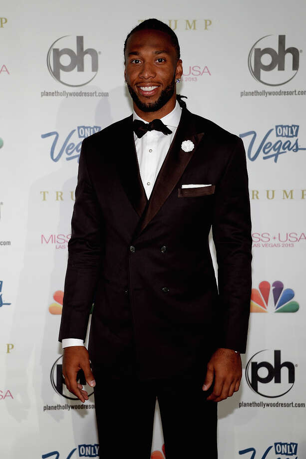 NFL player and pageant judge Larry Fitzgerald arrives at the 2013 Miss USA pageant at Planet Hollywood Resort & Casino on June 16, 2013 in Las Vegas, Nevada. Photo: Ethan Miller, Getty Images / 2013 Getty Images