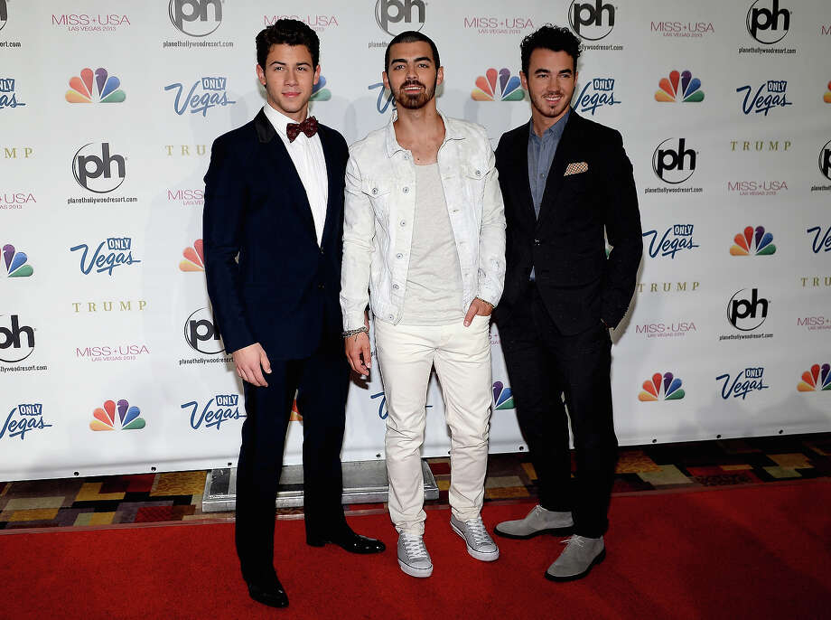 (L-R) Recording artists Nick Jonas, Joe Jonas and Kevin Jonas of the Jonas Brothers arrive at the 2013 Miss USA pageant at Planet Hollywood Resort & Casino on June 16, 2013 in Las Vegas, Nevada. Photo: Ethan Miller, Getty Images / 2013 Getty Images