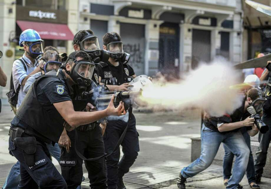 Police fire tear gas at demonstrators in Istanbul's Gezi Park. Protesters remained defiant as Prime Minister Recep Erdogan rallied supporters. Photo: Associated Press