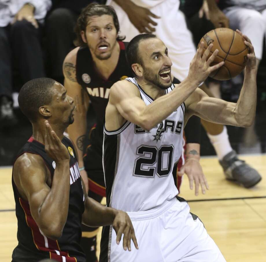 San Antonio Spurs' Manu Ginobili drives between Miami Heat's Chris Bosh, left, and Miami Heat's Mike Miller during the fist half of Game 5 of the NBA Finals at the AT&T Center on Sunday, June 16, 2013. (Jerry Lara/San Antonio Express-News)