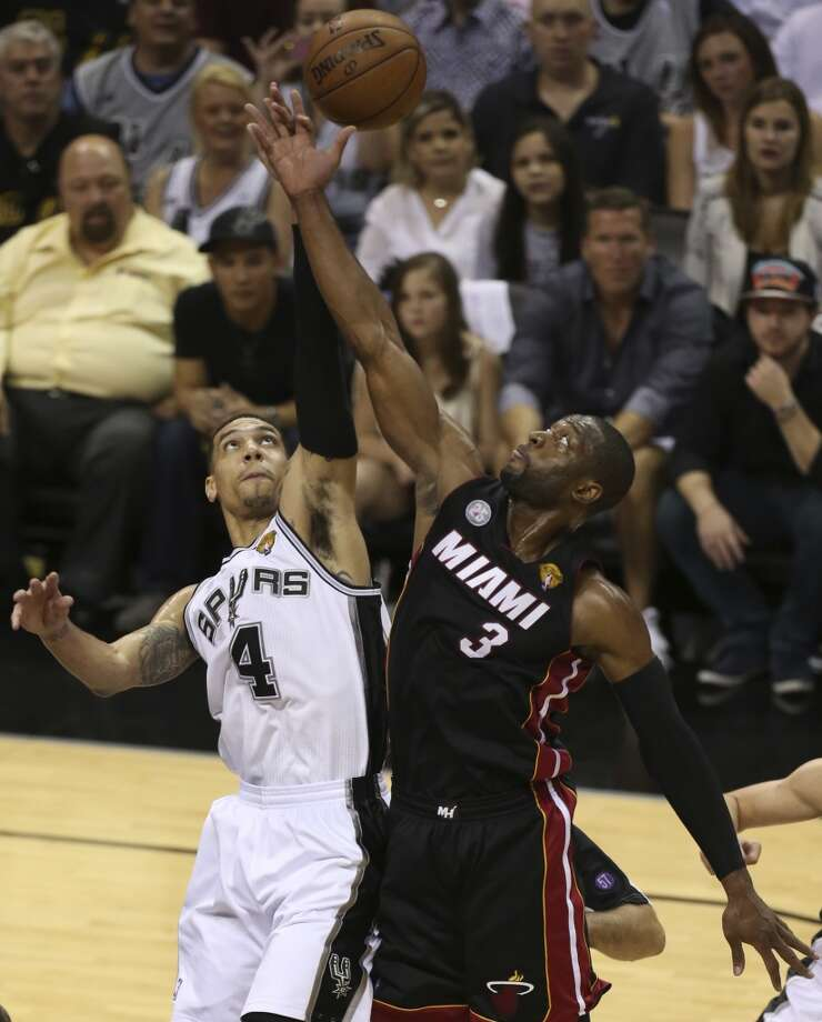 San Antonio Spurs' Danny Green and Miami Heat's Dwyane Wade go for a jump ball during the fist half of Game 5 of the NBA Finals at the AT&T Center on Sunday, June 16, 2013. (Jerry Lara/San Antonio Express-News)