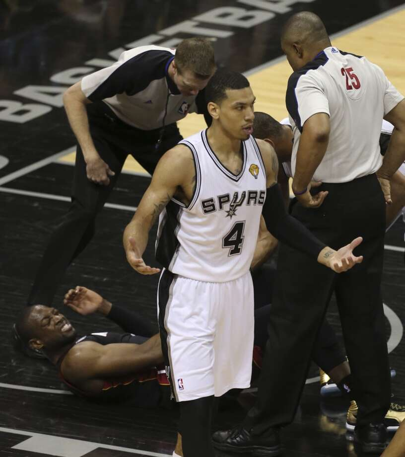San Antonio Spurs' Danny Green reacts after being called for a foul against Miami Heat's Dwyane Wade, on the ground, during the fist half of Game 5 of the NBA Finals at the AT&T Center on Sunday, June 16, 2013. (Jerry Lara/San Antonio Express-News)