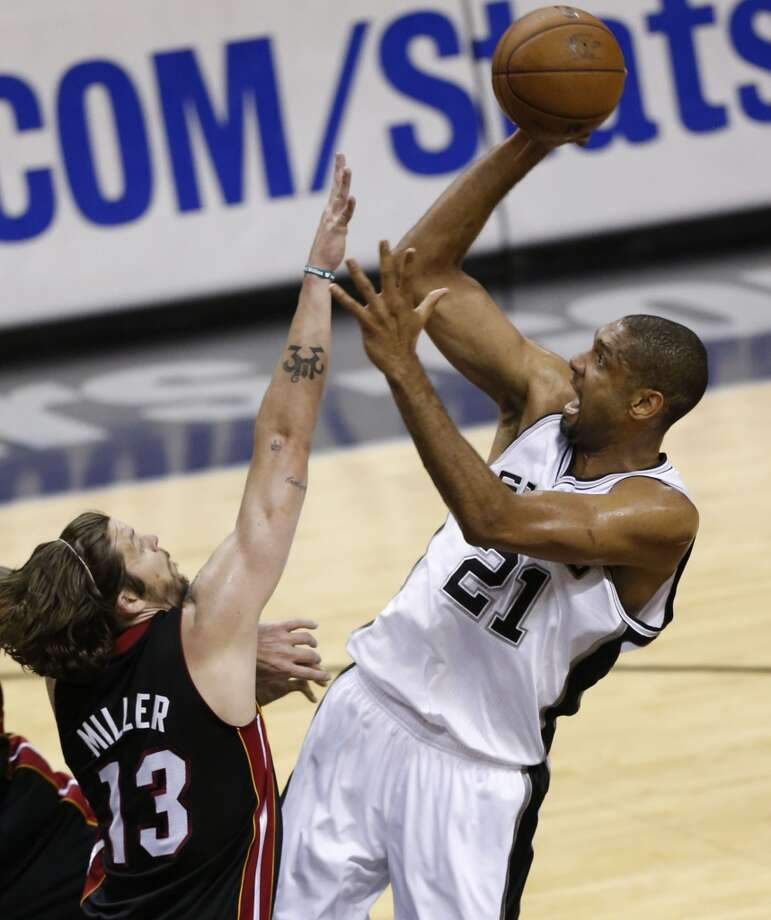 San Antonio Spurs' Tim Duncan shoots over Miami Heat's Mike Miller during first half action in Game 5 of the 2013 NBA Finals Sunday June 16, 2013 at the AT&T Center. (Edward A. Ornelas/San Antonio Express-News)