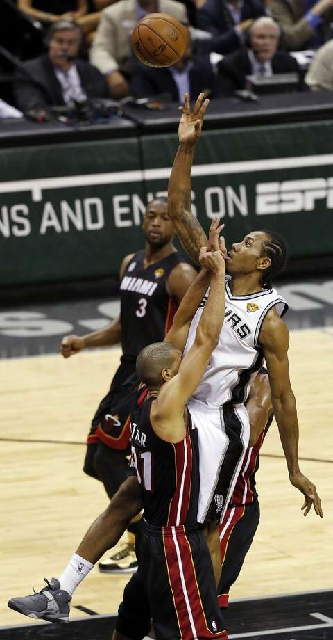 San Antonio Spurs' Kawhi Leonard shoots over Miami Heat's Shane Battier during first half action in Game 5 of the 2013 NBA Finals Sunday June 16, 2013 at the AT&T Center. (Edward A. Ornelas/San Antonio Express-News)