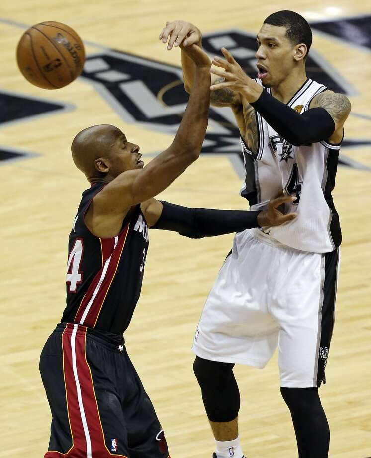 San Antonio Spurs' Danny Green passes around Miami Heat's Ray Allen during first half action in Game 5 of the 2013 NBA Finals Sunday June 16, 2013 at the AT&T Center. (Edward A. Ornelas/San Antonio Express-News)
