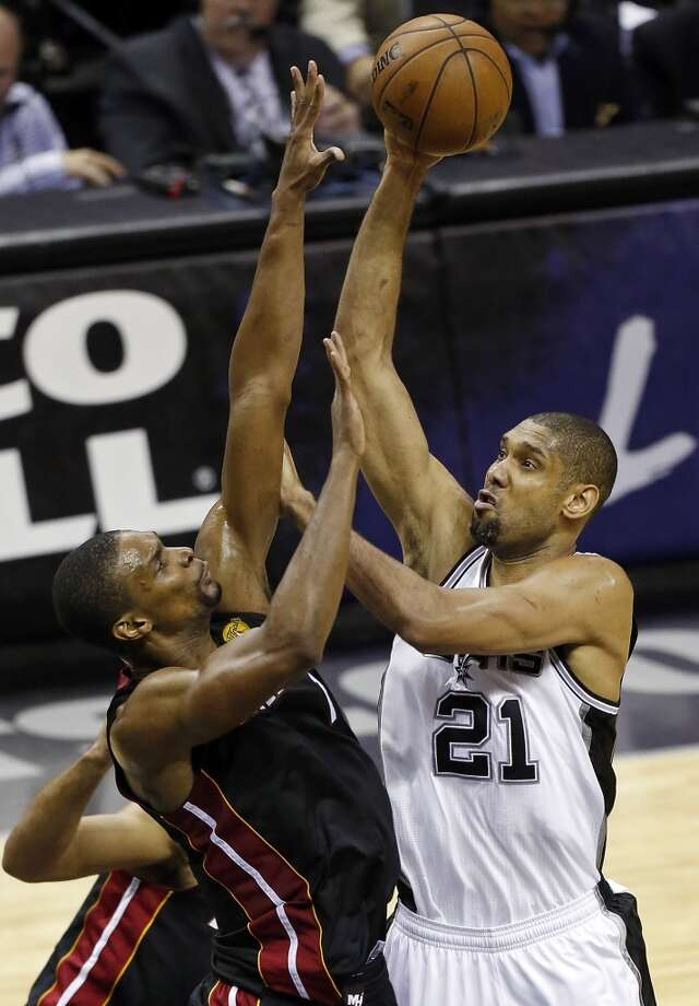 San Antonio Spurs' Tim Duncan shoots over Miami Heat's Chris Bosh during first half action in Game 5 of the 2013 NBA Finals Sunday June 16, 2013 at the AT&T Center. (Edward A. Ornelas/San Antonio Express-News)