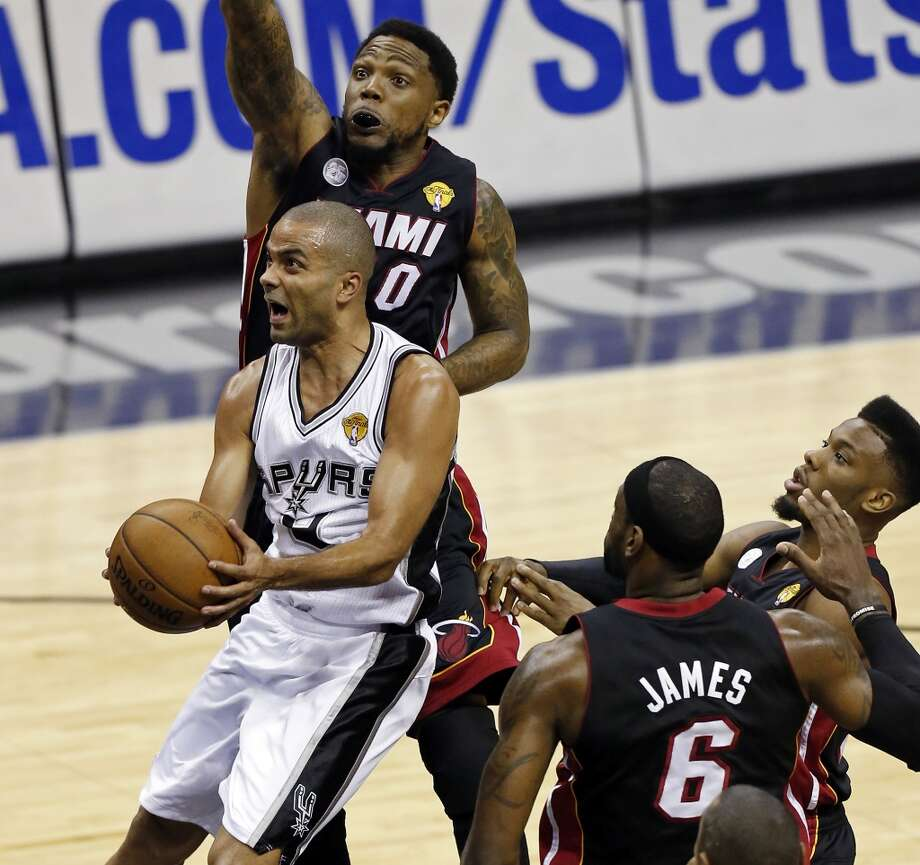 San Antonio Spurs' Tony Parker drives to the basket between Miami Heat's Udonis Haslem (from left), LeBron James, and Norris Cole during first half action in Game 5 of the 2013 NBA Finals Sunday June 16, 2013 at the AT&T Center. (Edward A. Ornelas/San Antonio Express-News)