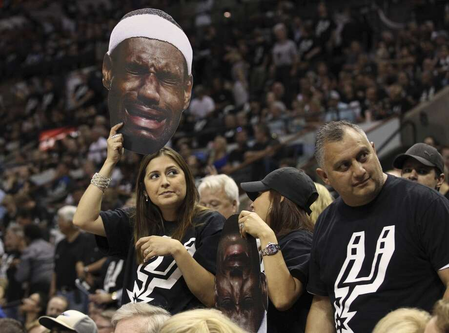 A Spurs fan holds up a sign showing Miami Heat's LeBron James crying during the first half of Game 5 of the NBA Finals at the AT&T Center on Sunday, June 16, 2013. (Kin Man Hui/San Antonio Express-News)