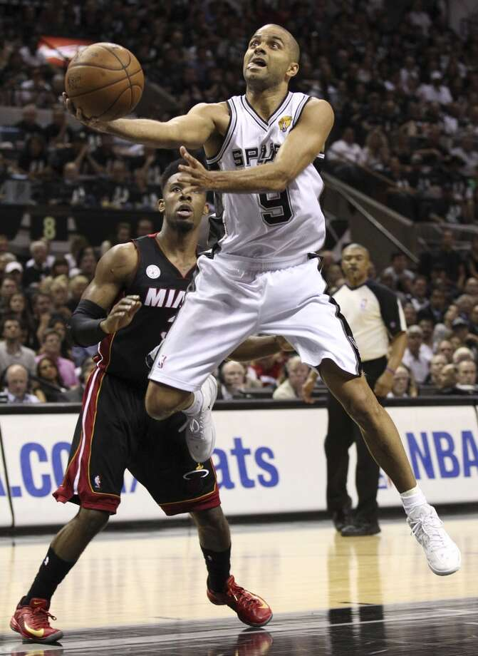 San Antonio Spurs' Tony Parker shoots over Miami Heat's Norris Cole during the first half of Game 5 of the NBA Finals at the AT&T Center on Sunday, June 16, 2013. (Kin Man Hui/San Antonio Express-News)