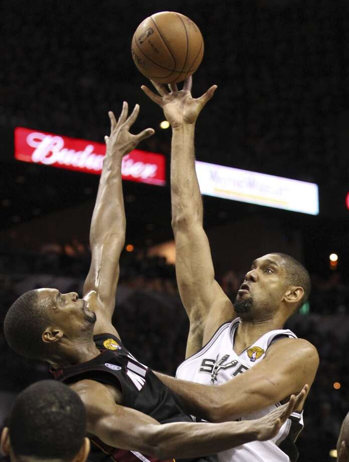 San Antonio Spurs' Tim Duncan shoots over Miami Heat's Chris Bosh during the first half of Game 5 of the NBA Finals at the AT&T Center on Sunday, June 16, 2013. (Kin Man Hui/San Antonio Express-News)