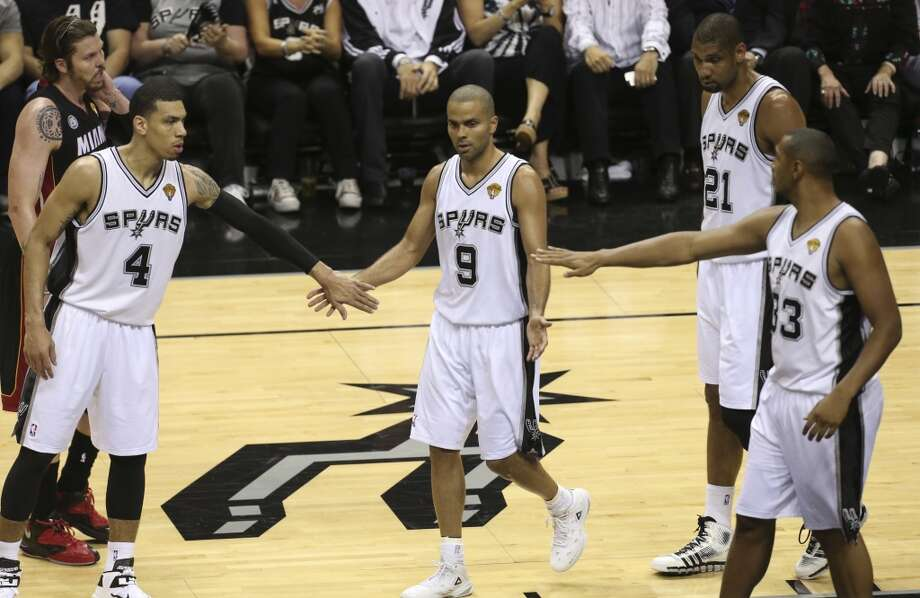 San Antonio Spurs' Tony Parker gives his fives to Danny Green, left, and Boris Diaw during the fist half of Game 5 of the NBA Finals at the AT&T Center on Sunday, June 16, 2013. (Jerry Lara/San Antonio Express-News)