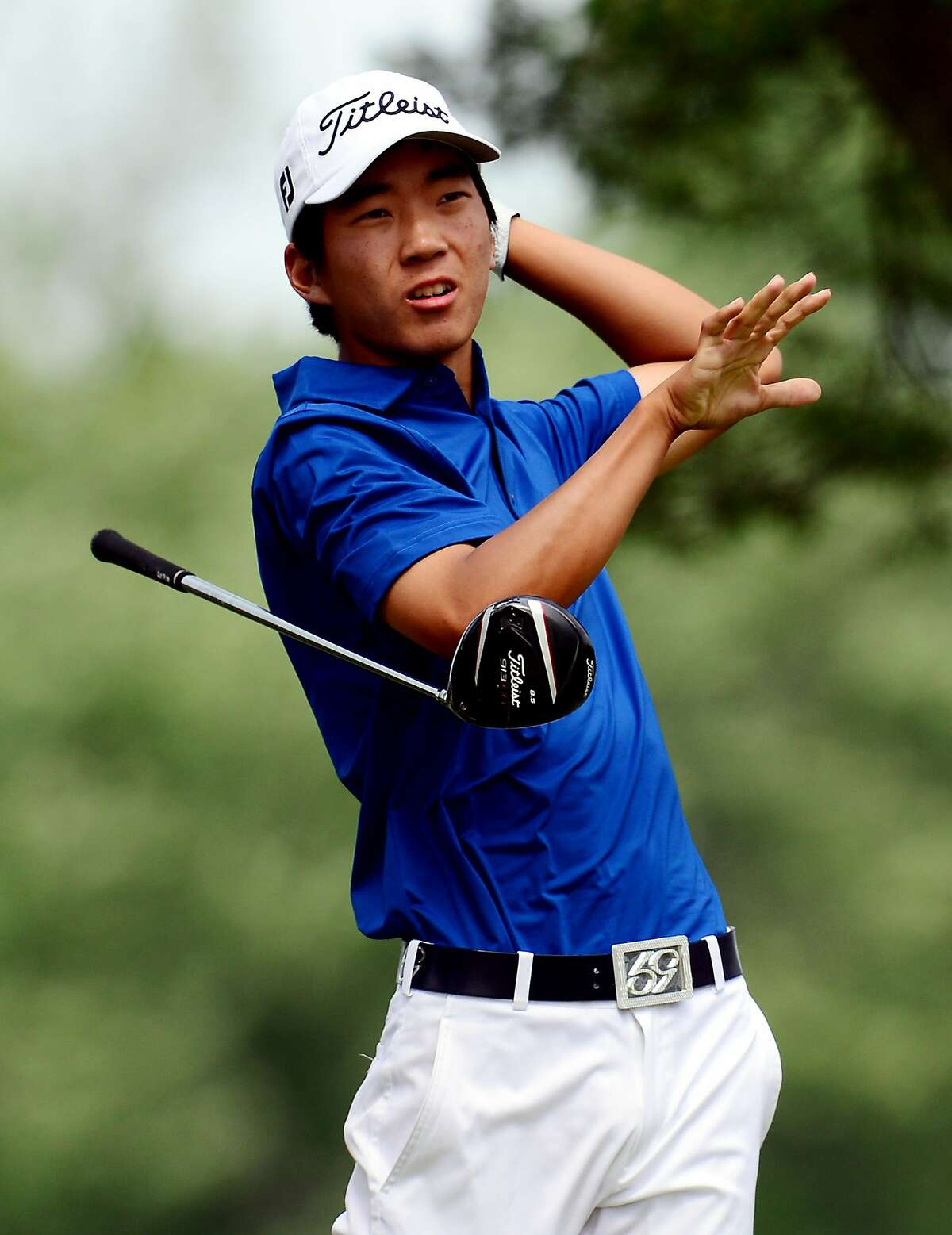 ARDMORE, PA - JUNE 16: Amateur Michael Kim of the United States lets go of his club after hitting his tee shot on the fifth hole during the final round of the 113th U.S. Open at Merion Golf Club on June 16, 2013 in Ardmore, Pennsylvania. (Photo by David Cannon/Getty Images)