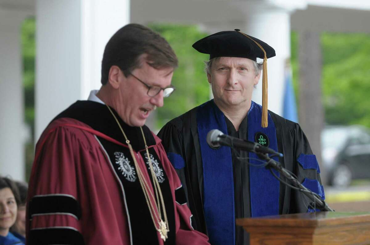 Union College president, Stephen Ainlay, left, bestows an honorary degree on scientist Clifford Tabin during the Union College Commencement Exercises on Sunday, June 16, 2013 in Schenectady, NY. (Paul Buckowski / Times Union)