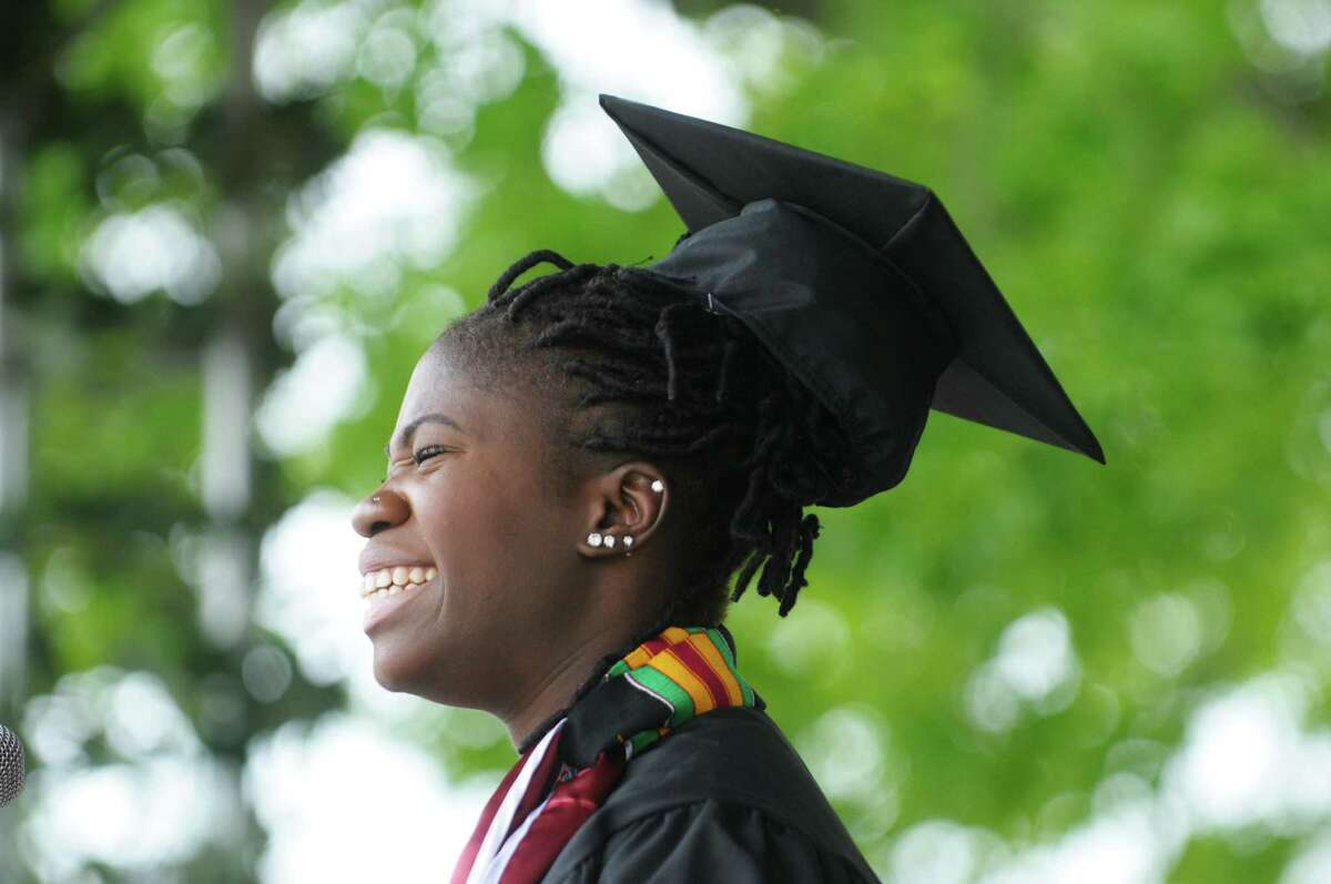 Graduate Kadiatou Tubman gives a big smile to her classmates before delivering the student address at the Union College Commencement Exercises on Sunday, June 16, 2013 in Schenectady, NY. (Paul Buckowski / Times Union)