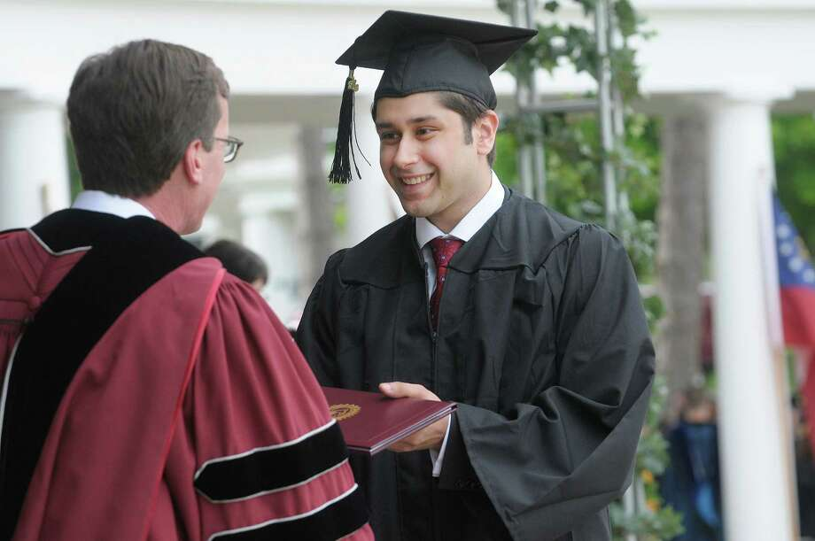 Arsalan Amin receives his degree from Union College president, Stephen Ainlay during the  Union College Commencement Exercises on Sunday, June 16, 2013 in Schenectady, NY.   (Paul Buckowski / Times Union) Photo: Paul Buckowski