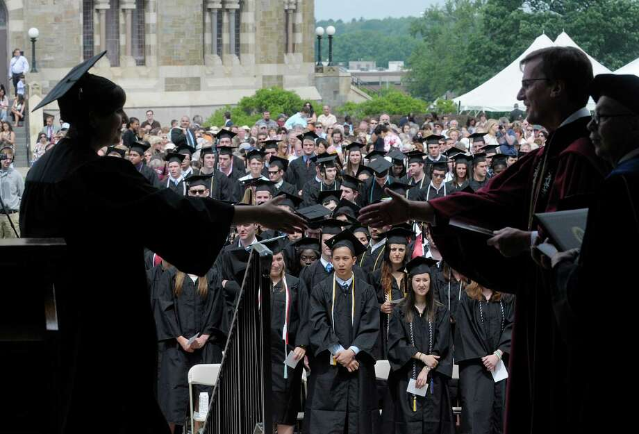 Lauren Brown, left, reaches out her hand to shake hands with Union College president, Stephen Ainlay as she walked across the stage to receive her degree at the Union College Commencement Exercises on Sunday, June 16, 2013 in Schenectady, NY.   (Paul Buckowski / Times Union) Photo: Paul Buckowski