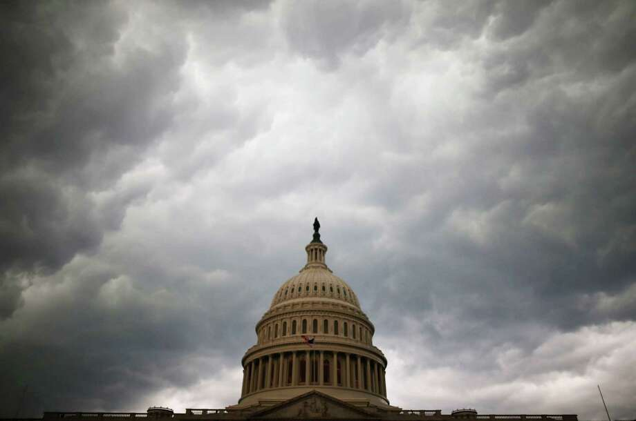 WASHINGTON, DC - JUNE 13:  Storm clouds fill the sky over the U.S. Capitol Building, June 13, 2013 in Washington, DC. Potentially damaging storms are forecasted to hit parts of the east coast with potential for causing power wide spread outages.  (Photo by Mark Wilson/Getty Images) Photo: Mark Wilson
