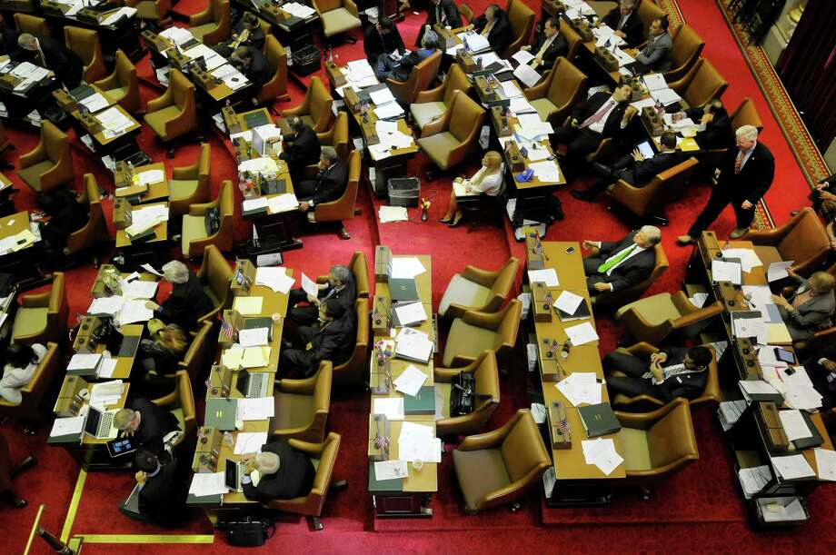 Members of the Assembly and their staff work on the floor of the chambers at Capitol on Tuesday, May 7, 2013 in Albany, NY.   (Paul Buckowski / Times Union) Photo: Paul Buckowski